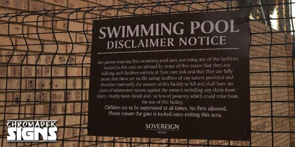 residential complex disclaimer swimming pool sign